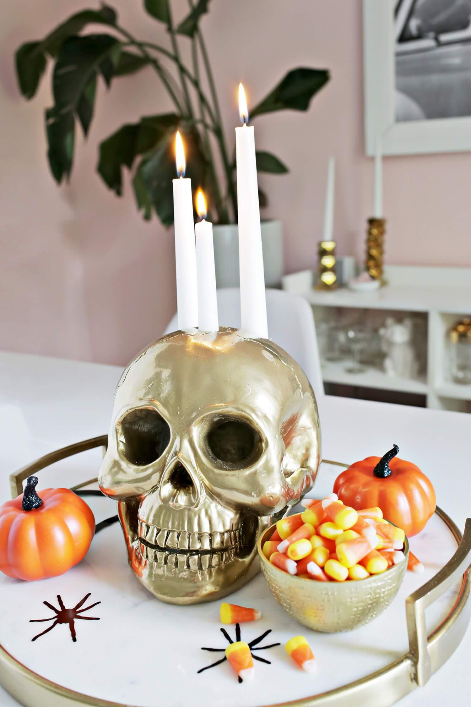 Skull candle holder with pumpkin for Halloween