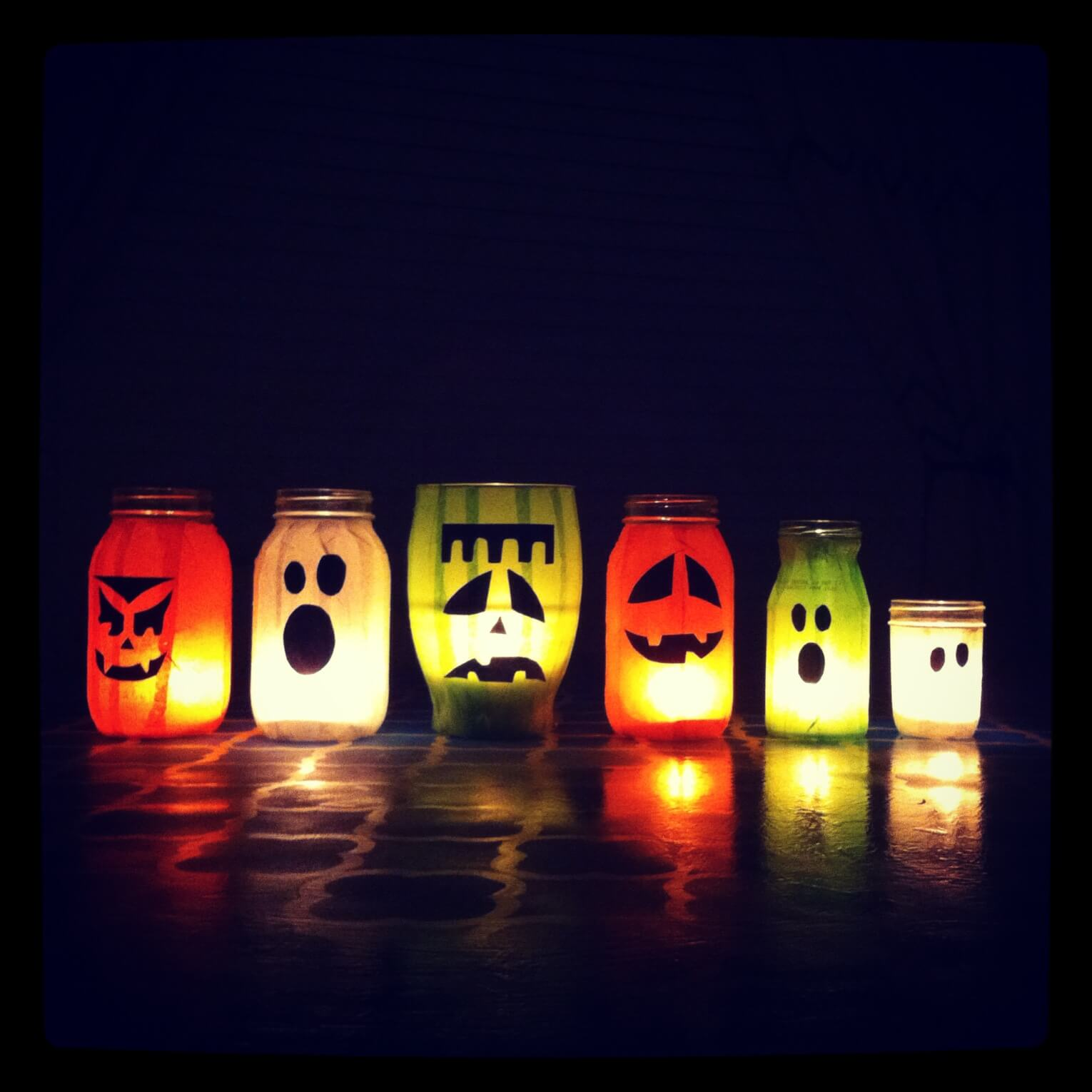 Ghost faced coloured lanterns for Halloween decoration