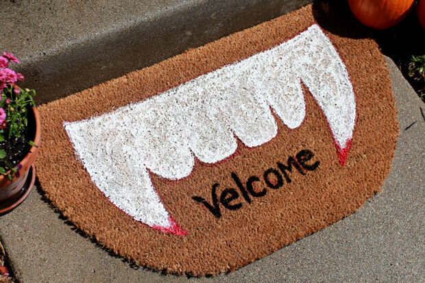Make a spooky welcome mat.