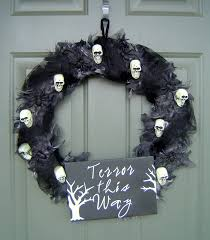 Scary skull wreath on front door Halloween decoration