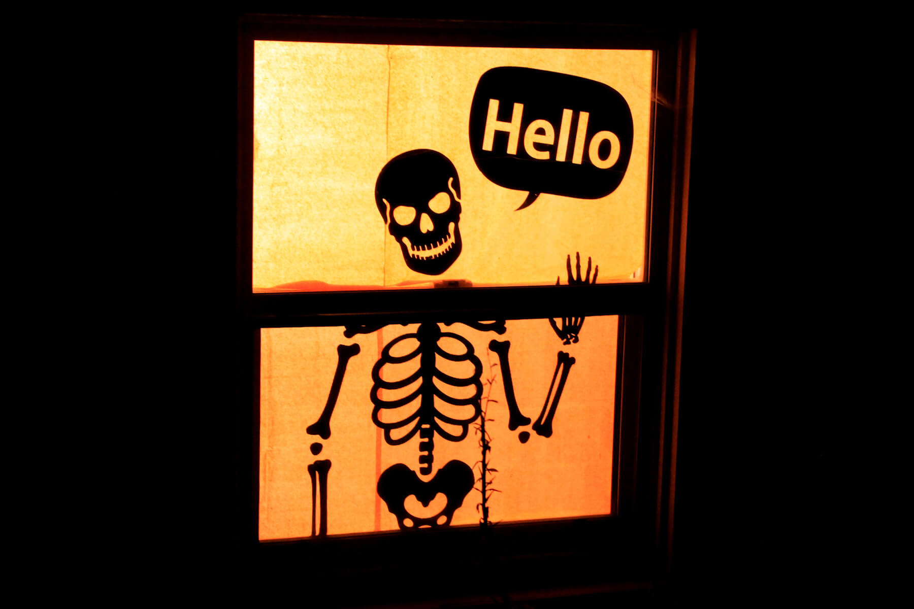 Skeleton says hello silhouette window decoration for Halloween