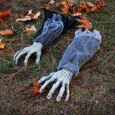 Spooky hands in garden Halloween decoration