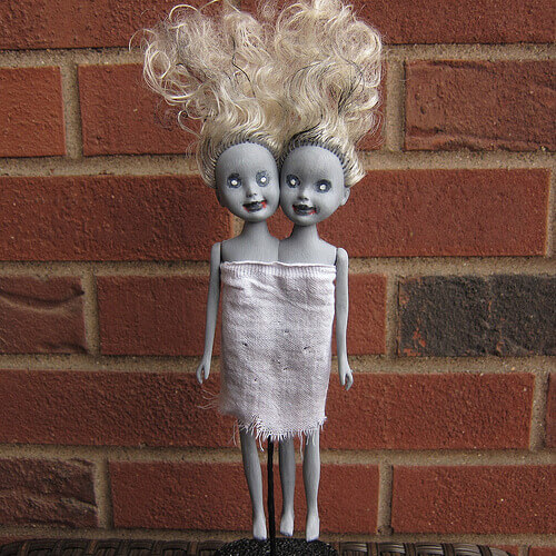 Zombie siamese twin dolls.