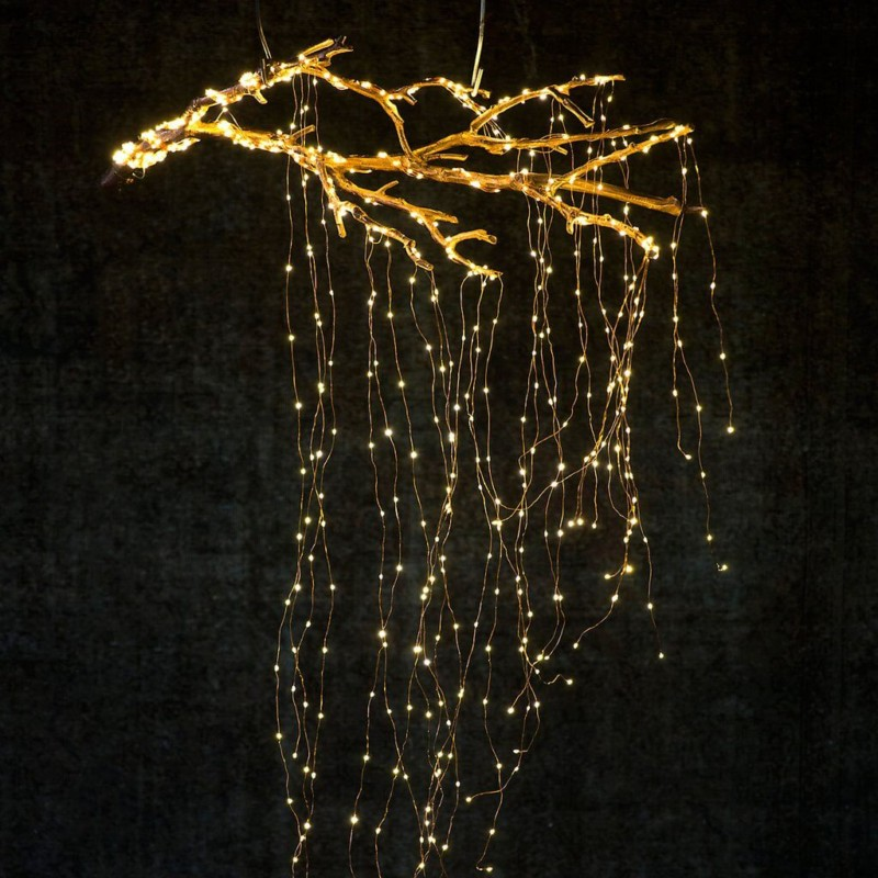 Create cascade lights from suspended branch Christmas decorations ideas for home