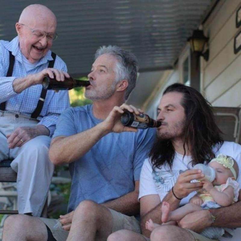 dads feeding their babies Family Photo Shoot Idea