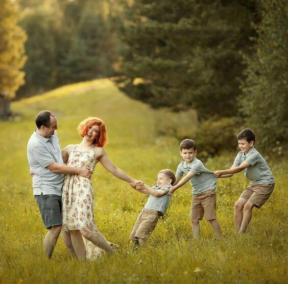 kids dragging parents Family Photo Shoot Idea